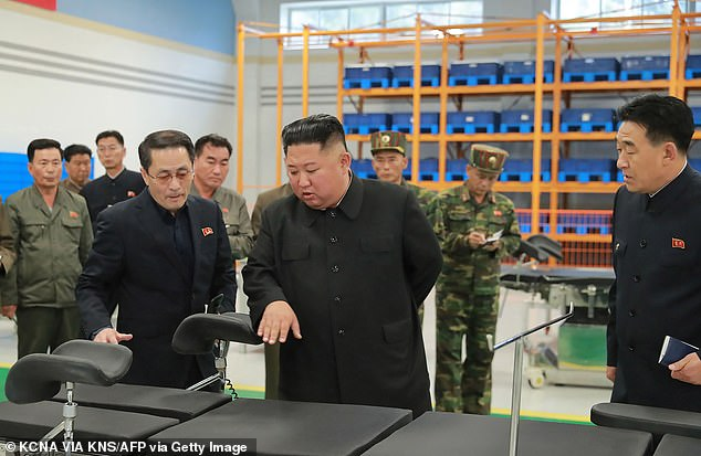 Mr Chol said the US would fail if it used the 'deep personal relations' between Mr Kim (pictured inspecting the appliances at the medical centre yesterday) and Trump to 'delay tactics'