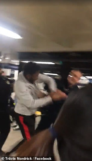 After the officer throws a punch, the teen retaliates, and the two begin to exchange blows