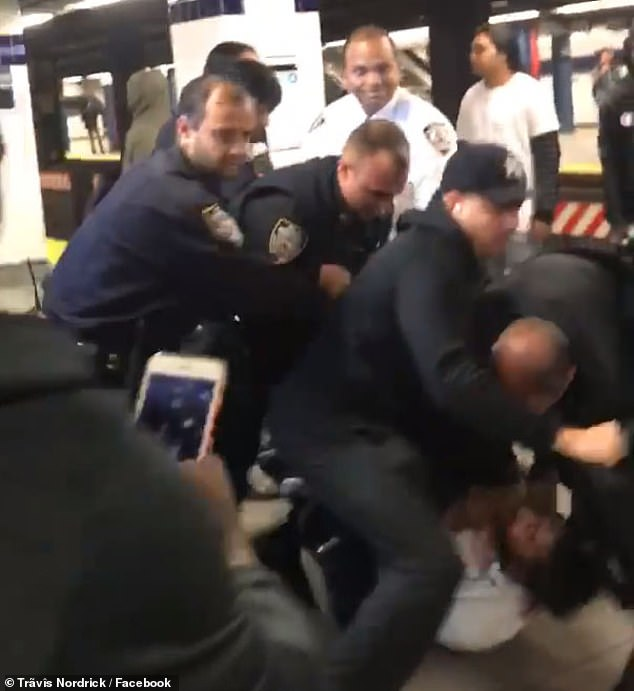 Moments later, a number of fellow officers move in to break up the second fight and place the teen under arrest. The teen is seen at the bottom right on the ground