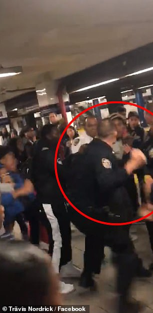 The images above taken from amateur video shot inside a downtown Brooklyn subway station on Friday afternoon shows a police officer punch a teenager during a wild melee
