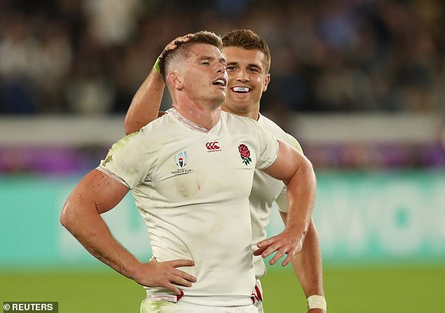 Owen Farrell (left) and Henry Slade (right) are pictured after their efforts helped England over the line in the Rugby World Cup semi final