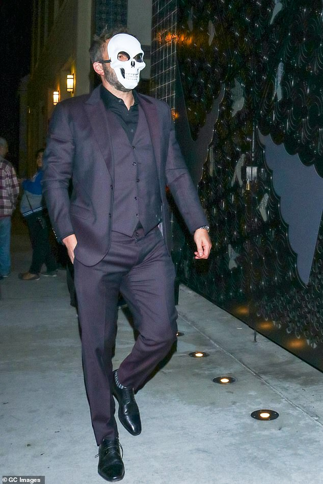 Tough: Ben Affleck had trouble walking and appeared to stumble against a vehicle after leaving a Halloween party on Saturday night in Los Angeles