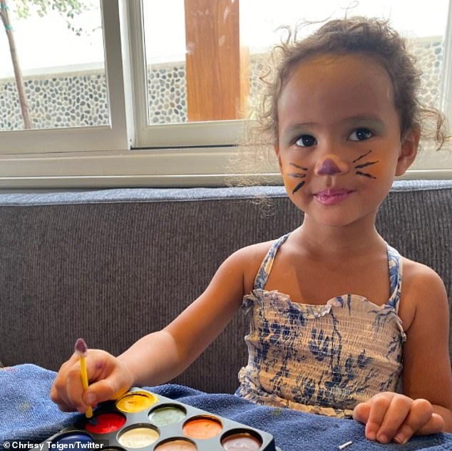 Just like mama: She shared a video of Luna putting on some face paint on herself to transform into a cat for Halloween