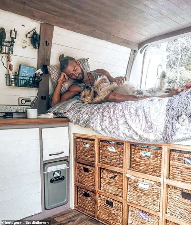 Keen explorers, such as Brad pictured here with his dog in Ibiza, have also installed cupboards and chests of drawers in their portable homes