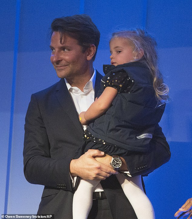 Doting father: Bradley Cooper brought his daughter Lea De Seine, two, along to the 22nd Annual Mark Twain Prize for American Humor ceremony in Washington, D.C. on Sunday