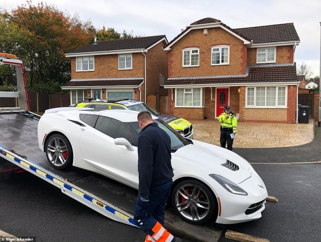 On Saturday police seized three expensive cars and a motorbike belonging to an Irish haulage company boss and his wife from their drive in Warrington
