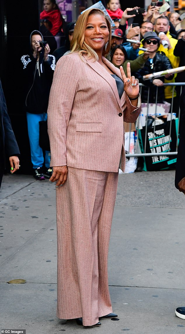 Busy day: Queen Latifah made an appearance in a pink power suit on Monday morning after her visit to Good Morning American and Live with Kelly and Ryan