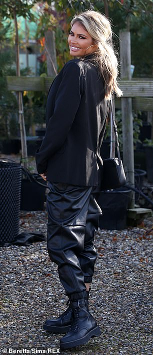 She's got it in the bag: Keeping her look coordinated, she toted a black handbag