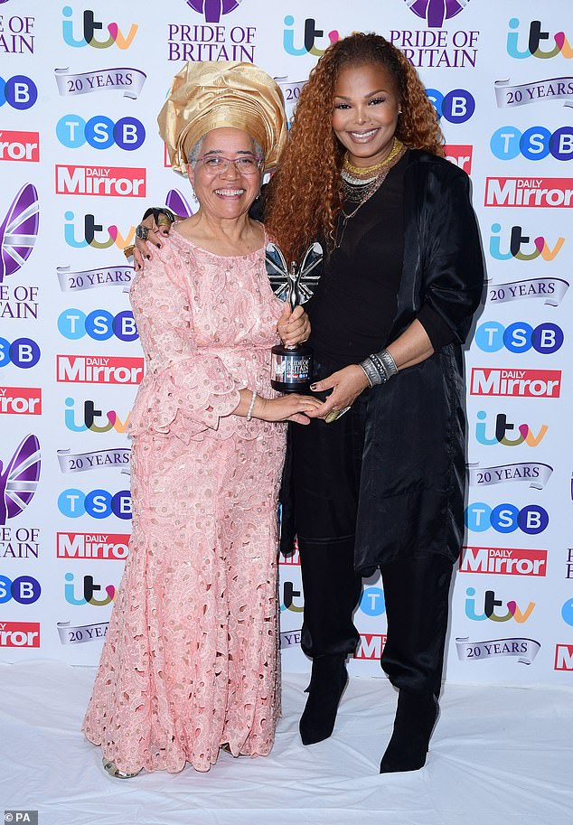 Winner: Janet looked delighted as she posed withDame Elizabeth Anionwu who picked up the Lifetime Achievement Award
