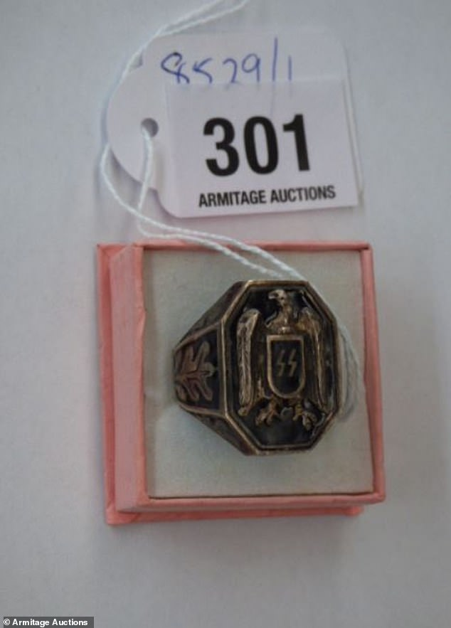 Chairman of Jewish group Anti-Defamation Commission, Dvir Abramovich, said he was shocked to see Nazi items again put up for auction. Pictured: An SS ring for sale at the auction