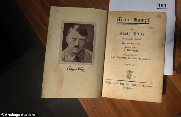 Several items of Nazi memorabilia are set to go under the hammer in Tasmania, despite calls from the Jewish community to end the 'perverse' sales. Pictured: A copy of 'Mein Kampf' for sale at the auction