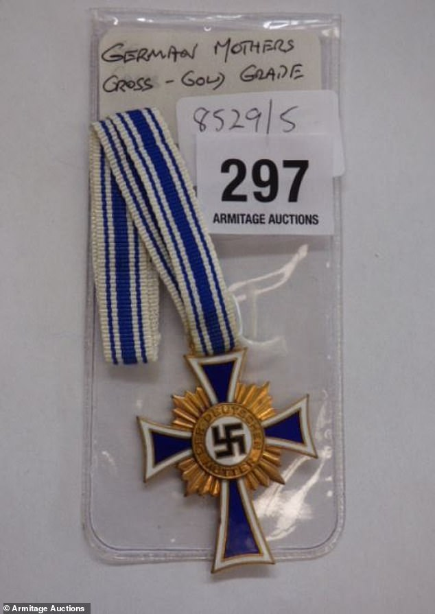 Armitage Auctions in Launceston will on Wednesday put German war artefacts up for bidding including medals with swastikas. Pictured: A medal with a swastika on it for sale at the auction