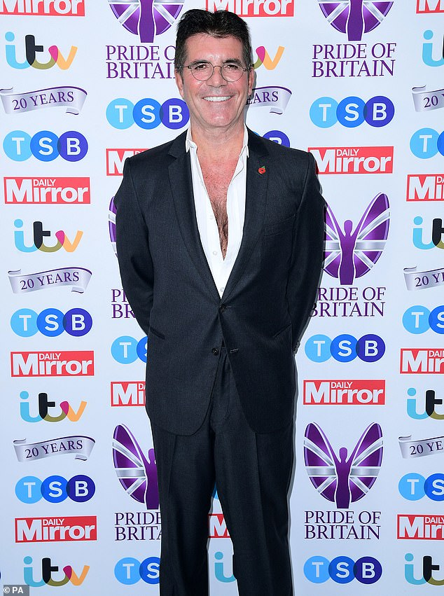 Appearance: Simon's cancellation comes after he made an appearance with partner Lauren at Monday's Pride of Britain Awards (pictured)