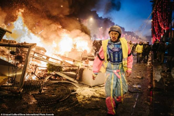 This eye-opening picture of a yellow vest protest in Paris has been shortlisted in theDocumentary & Photojournalism category