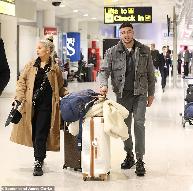 Travel: Molly-Mae Hague, 20, and Tommy Fury, 20, looked casual as they arrived in Manchester Airport after flying in from a photoshoot in Paris on Wednesday