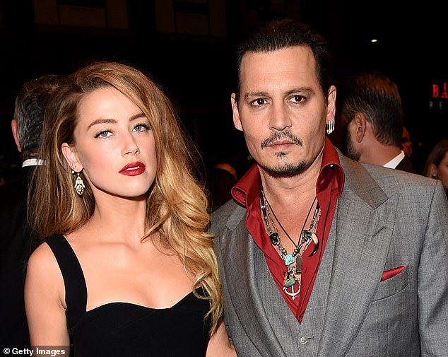 Happier times:Amber's lawyer Roberta Kaplan told the outlet that Johnny and TMG parted ways in 2016 amid a 'bitter dispute' and claims that they were 'aware that Mr. Depp abused Ms. Heard and pressured his employees to make false public statements denying that abuse;' pictured together September 14, 2015 in Toronto