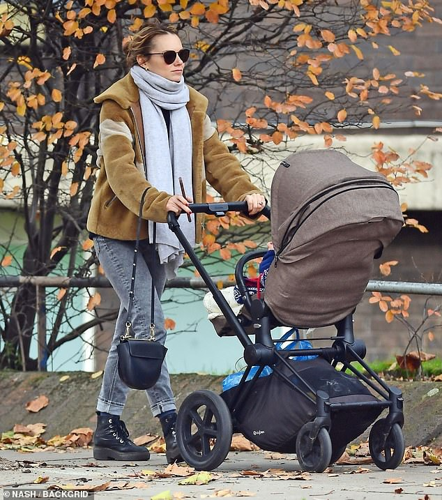 Stroll: Kara Tointon looked relaxed as she stepped out for a stroll with baby son Frey in London on Thursday