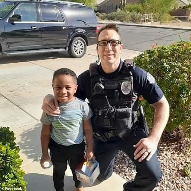 Officer Randolph 'Scott' Valdez (right) brought 5-year-old Charlie (left) a McDonald's Happy Meal after he called 911 and asked for a Happy Meal