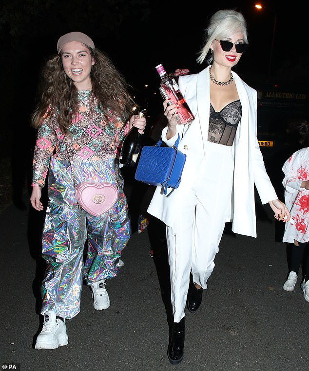 Oops:Yet Scarlett risked a fashion faux pas as two of Jonathan's other guests decided to dress as Ab Fab's Eddie and Patsy (pictured)