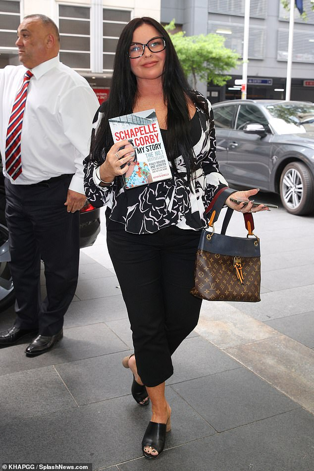 She has expensive taste! Schapelle Corby (pictured) showed off her $3,000 Louis Vuitton handbag at the launch of her autobiography, My Story, in Sydney on Thursday