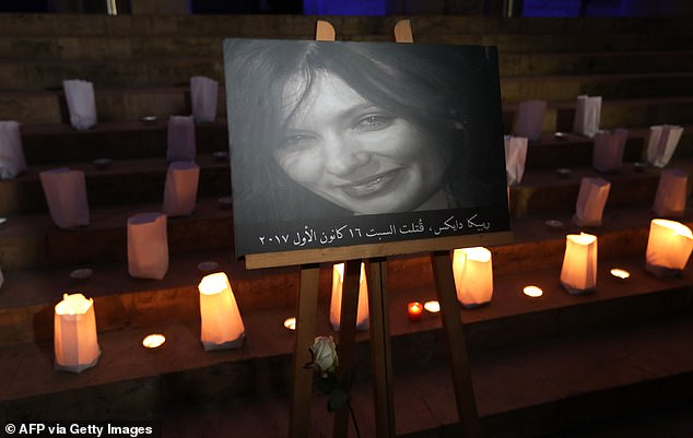A portrait of Rebecca Dykes is displayed at a candlelit vigil in Beirut in December 2017, shortly after the British embassy worker was killed