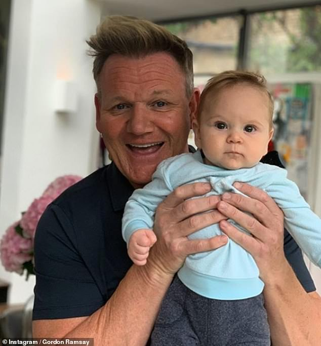 Supporting: The chef, pictured with his youngest son, wished the team 'good luck' ahead of their game against South Africa and said 'dinner's on me' when they return to England