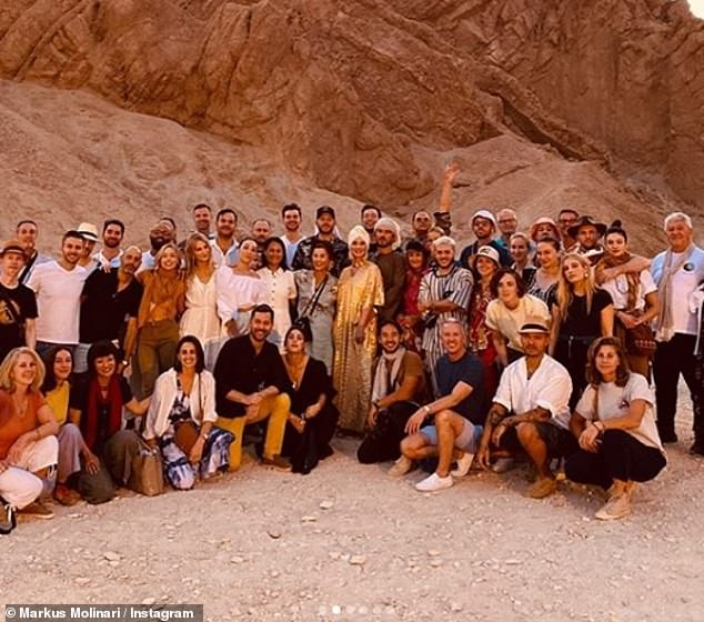 Amazing: The singer (seen above in the centre dressed in gold) took an enormous group of friends to the Egyptian desert, where they enjoyed camel rides