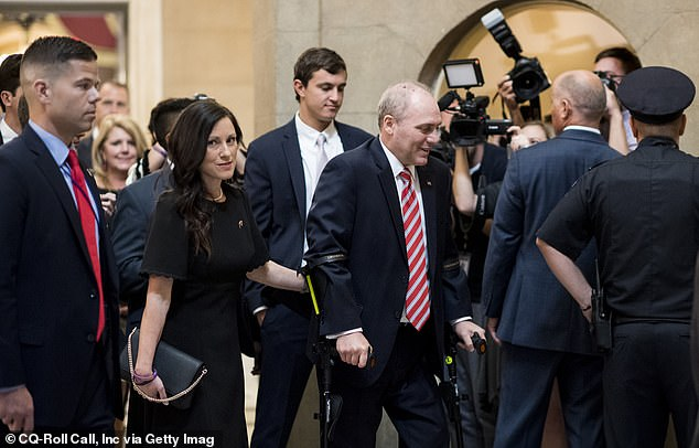 House Majority Whip Steve Scalise, R-La., walks with his wife Jennifer from the House chamber to his office in the Capitol on his first day back in Congress on Thursday, Sept. 28, 2017. Scales was shot during baseball practice for the Congressional Baseball Game in June