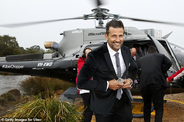What a hunk!As usual, the former Bachelor star oozed sex appeal in a suave black suit teamed with a smart grey tie