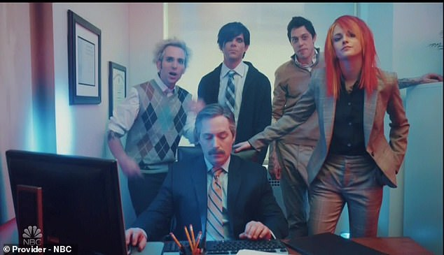 Loving the man: Kristen returned in a digital short as an office worker who broke into a pop-punk music video after being criticized for her punky attire — until she got a chance at a promotion and suddenly found herself buying into the corporate program