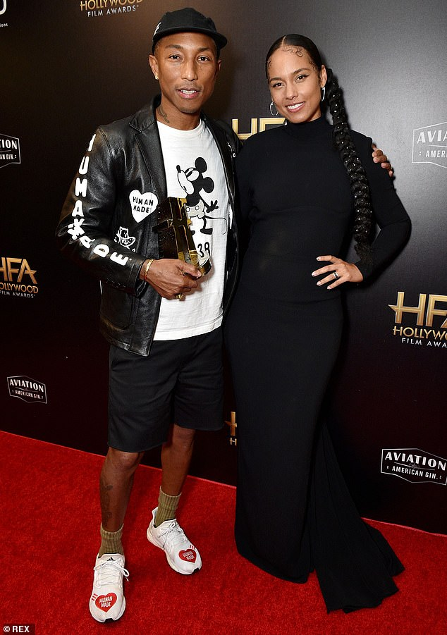 The mouse: She posed on the red carpet with Williams, who donned a hand-painted black leather jacket over a Mickey Mouse t-shirt
