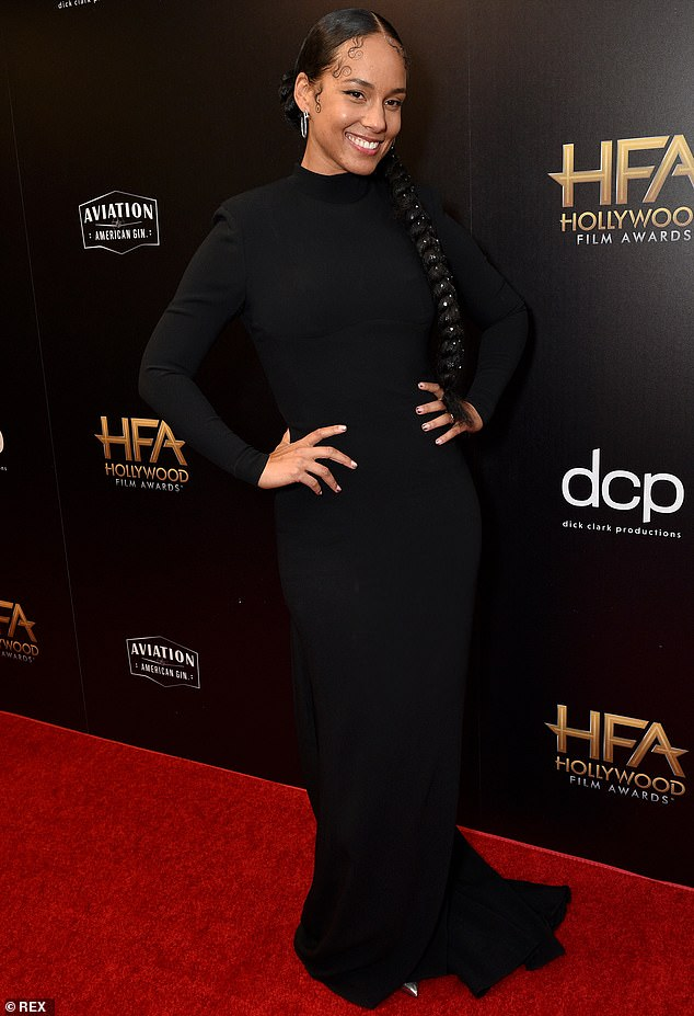 Stunning in Stella: Alicia Keys stunned Sunday at the Hollywood Film Awards in a skintight floor-length black Stella McCartney gown