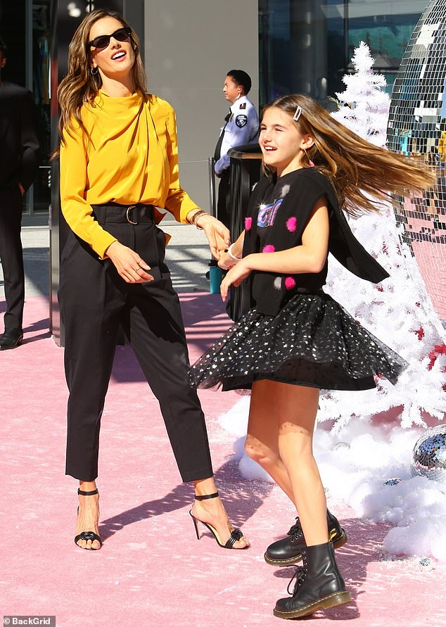 Get down:The wintry red carpet scene, combined with the warm Southern California weather, got the mother–daughter duo on their feet and dancing ahead of the film