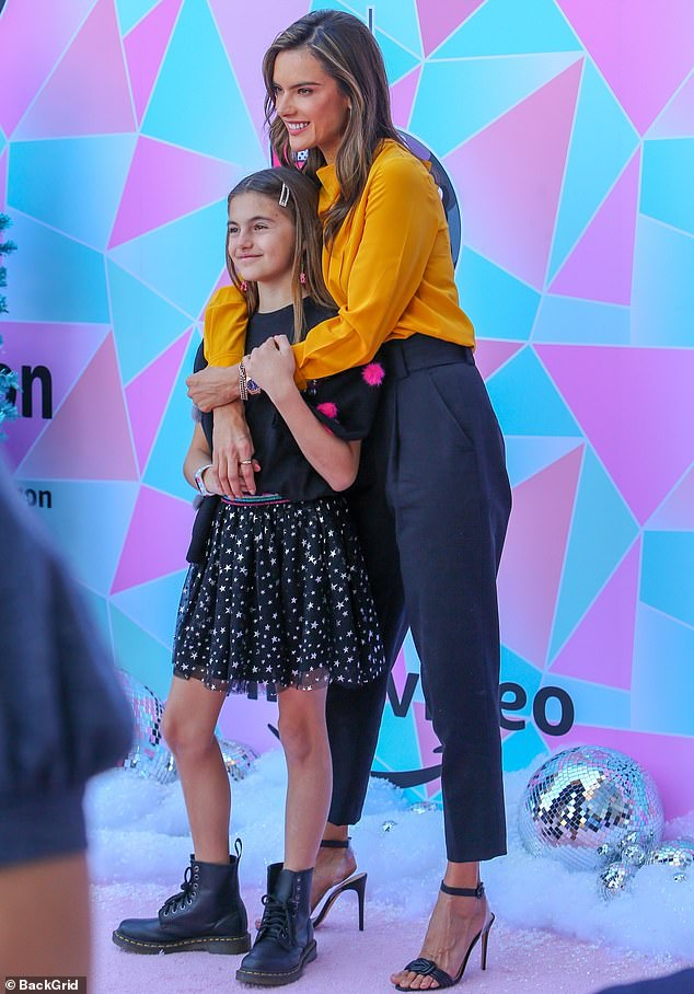 Elegant: Alessandra looked ready for business in her mustard yellow blouse with a ruched front