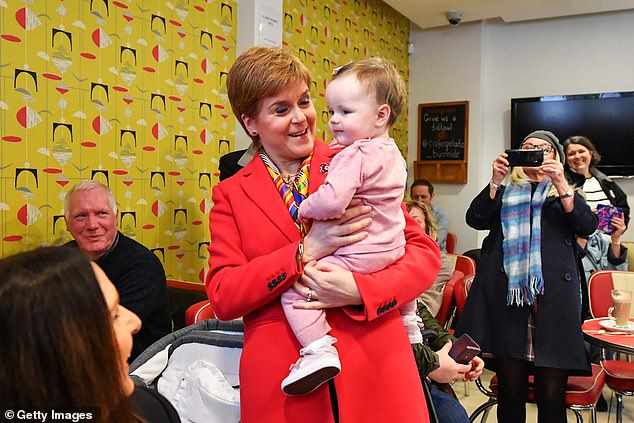 Ms Sturgeon (pictured visiting a pharmacist today) accused broadcasters of being stuck in the past as she demanded to join the TV debate between Boris Johnson and Jeremy Corbyn