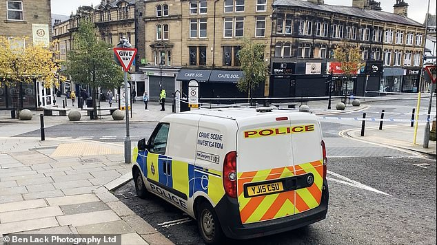 Halifax city centre taped off by West Yorkshire Police after the murder of a 26 year old woman in the early hours of Sunday morning