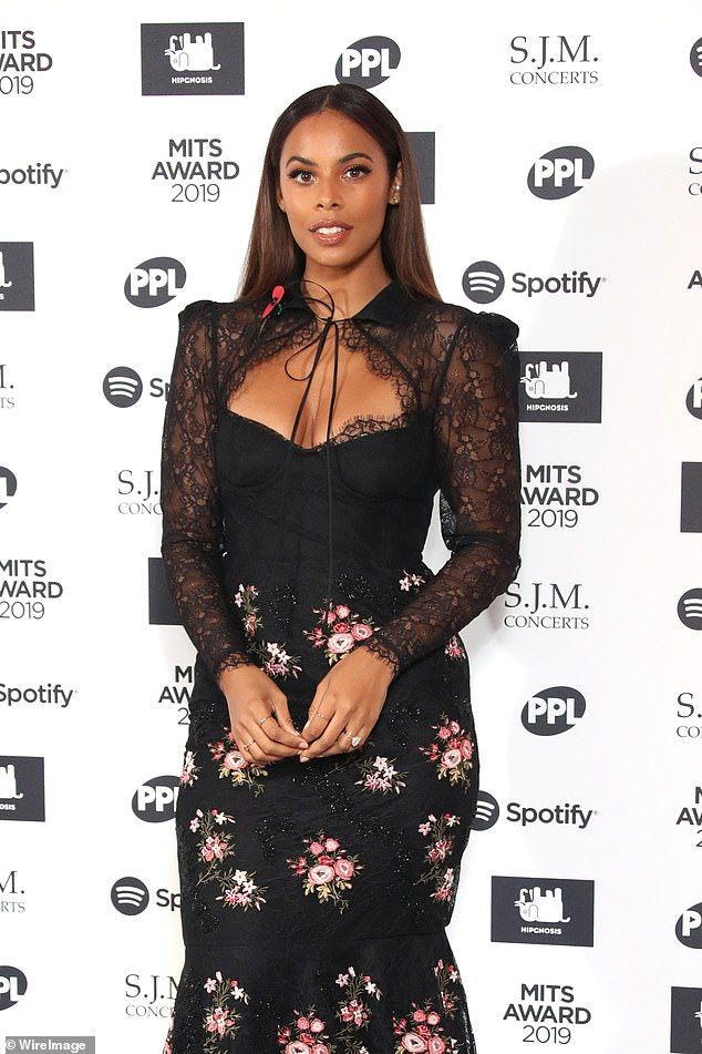 All in the details: The musician ensured all eyes were on her in her black and pink ensemble, complete with a bustier bodice and sheer long sleeves