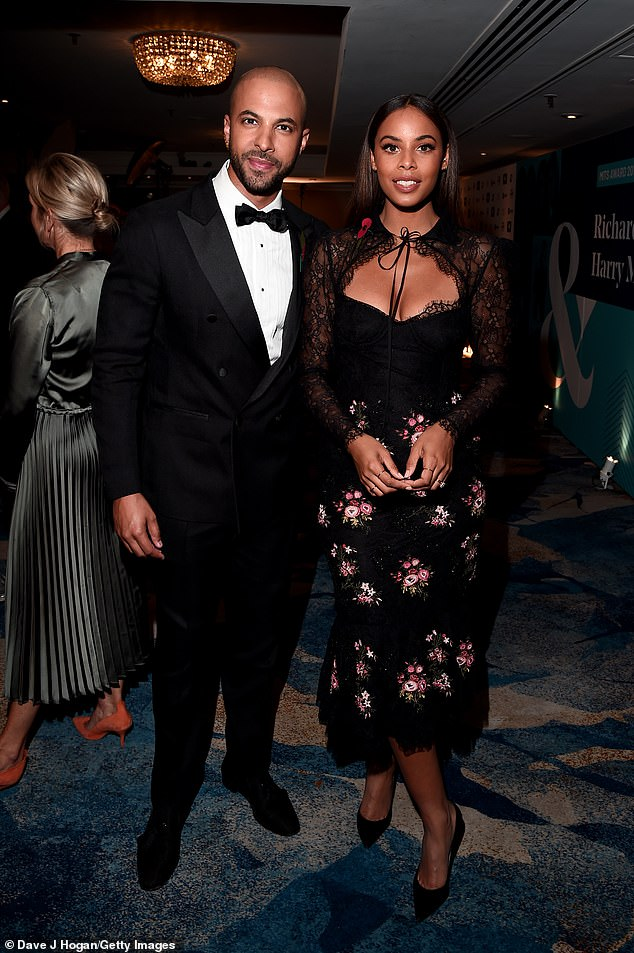 Dapper: JLS star Marvin, 34, cut a suave figure in a classic black tuxedo, teamed with a crisp white shirt, a bow tie and black brogues