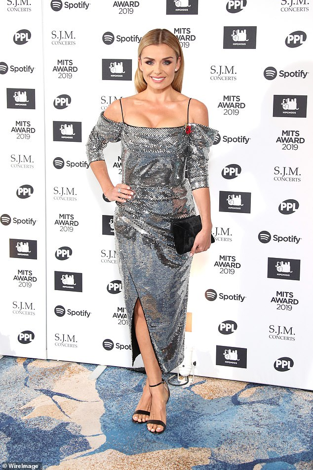 Sizzling: Katherine Jenkins caught the eye in a metallic silver dress, finished off with a thigh-high slit