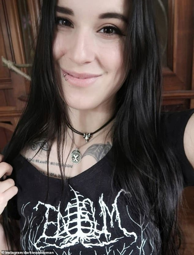 Not too spooky! Another woman, believed to be from Switzerland, posted this adorable selfie online as she showed off her trendy lip-piercings, cool tattoos and gothic t-shirt