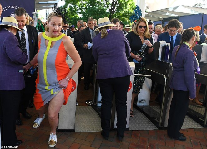 The early bird catches the worm: One woman was extremely determined to get the best seat in the house as she ran through the barriers at around 9am