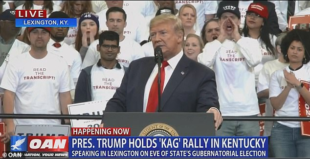 Supporters wearing 'read the transcript' t-shirts appeared behind President Trump