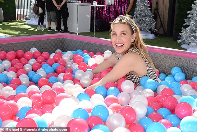 Fun for everyone!And the ball pit wasn't just for kids, with Whitney also trying her hand inside the rainbow playground as well