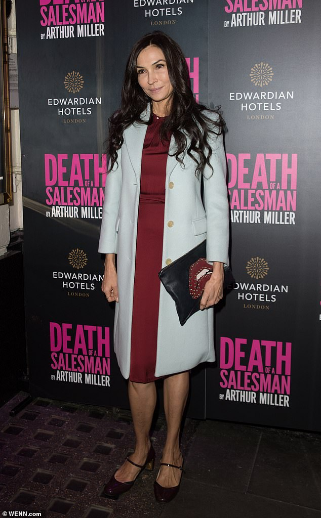 Fashion: The actress cut a stylish figure at the event, donning a burgundy knee-length dress which she paired with a pale blue coat