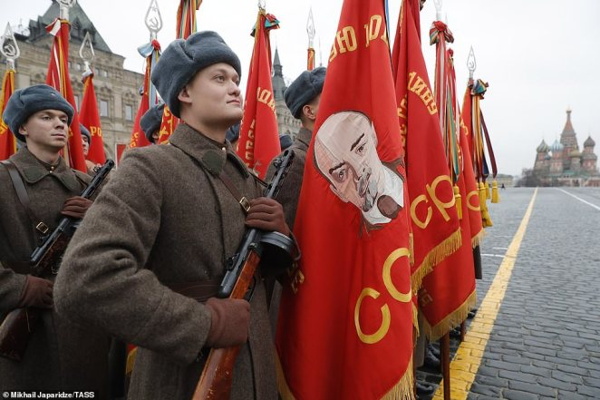 Servicemen with red banners during a dress rehearsal of a march in Red Square marking the 78th anniversary of the 7 November 1941 October Revolution Parade
