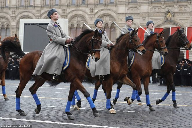 Servicemen on horses during a dress rehearsal of a march in Red Square marking the 78th anniversary of the 7 November 1941 October Revolution Parade