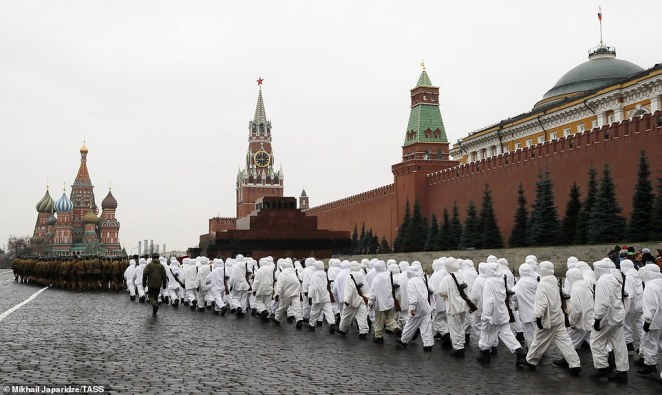 Servicemen and women parade through Red Square in front of the Moscow Kremlin building (left) during the huge dress rehearsal