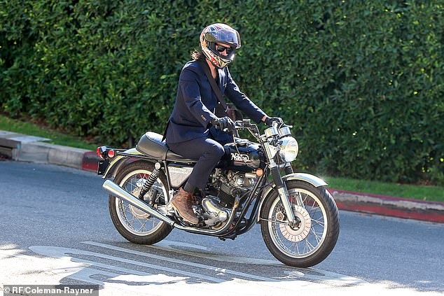 On the road again: Keanu Reeves, 55, was snapped riding his motorcycle in LA Tuesday as the Internet was abuzz about his outing with his artist girlfriend Alexandra Grant, 46, over the weekend