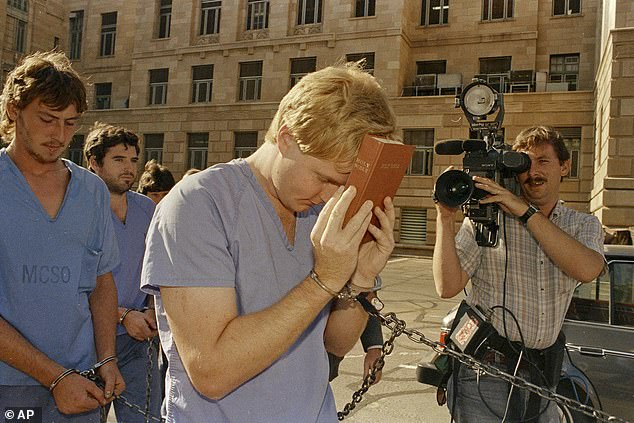 Heber LeBaron covers his face with a bible while he and his half brother Douglas Barlow leave a court hearing in 1988.The two men were the sons of polygamist sect leader, the late Ervil LeBaron. LeBaron and his Church of the Lamb of God were linked to slayings from Utah to Mexico and the LeBaron brothers are being held in connection with slayings in Texas and Utah