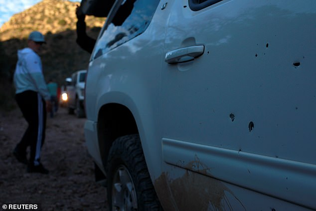 Bullet impacts are seen on the door of one of the trucks. Nine members of the LeBaron family were attacked eight miles apart while traveling in a convoy of three SUVS on a dirt road